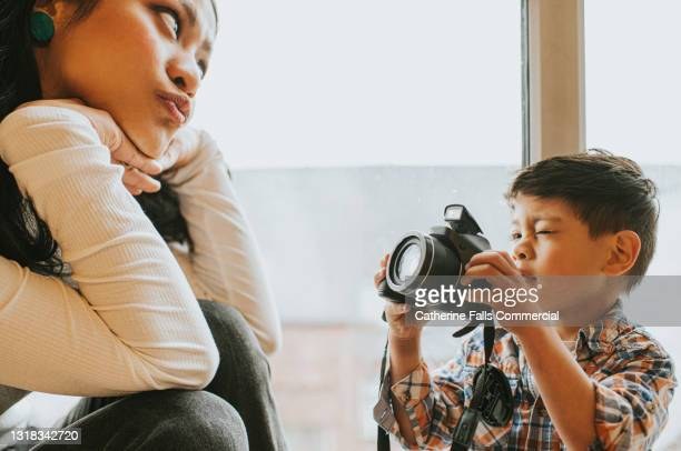 a boy photographs a woman, who poses comically - alternative pose stock pictures, royalty-free photos & images