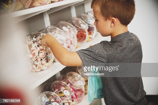 Boy picking sweets in a candy store