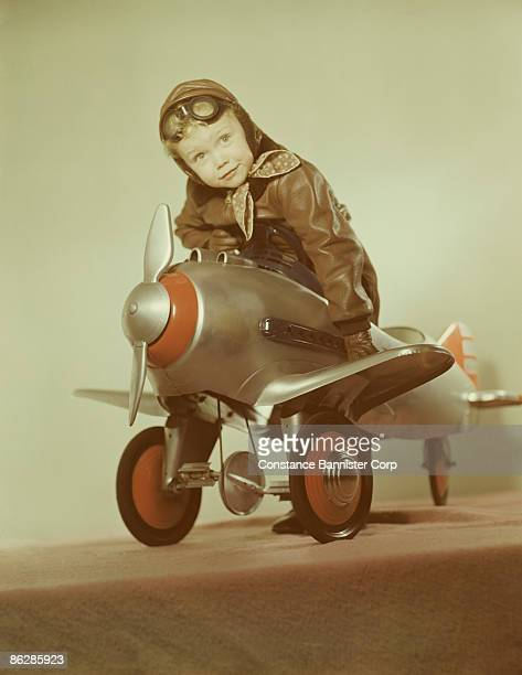 Boy pilot playing in toy airplane