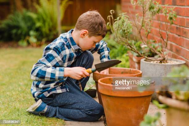 Boy planting and sowing seeds