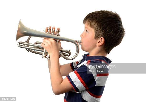 Boy playing a trumpet