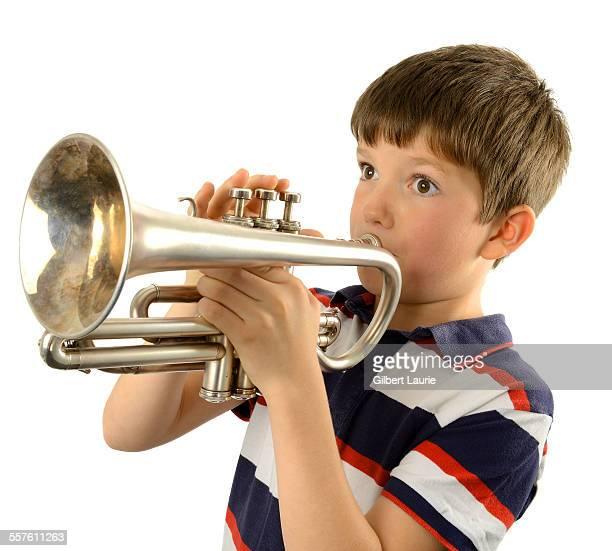 boy playing a trumpet - トランペット ストックフォトと画像