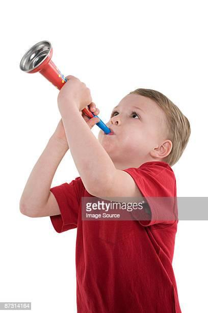 A boy playing a trumpet