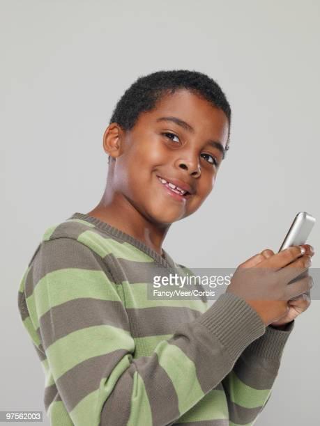 boy playing a video game - portable information device imagens e fotografias de stock