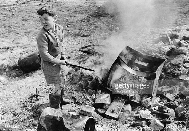 A boy playing at an adventure playground set up by the National Playing Fields Association in Crawley New Town Sussex May 1955 Here children can play...