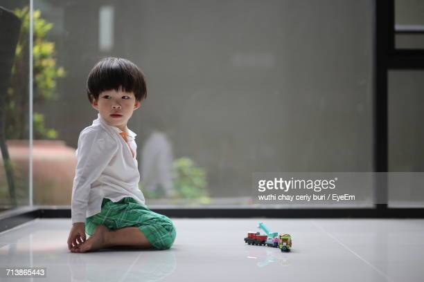 Boy Playing At Home