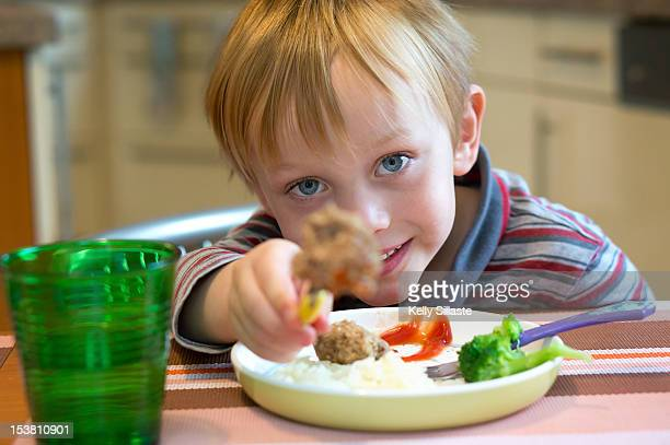 Boy playing at lunch