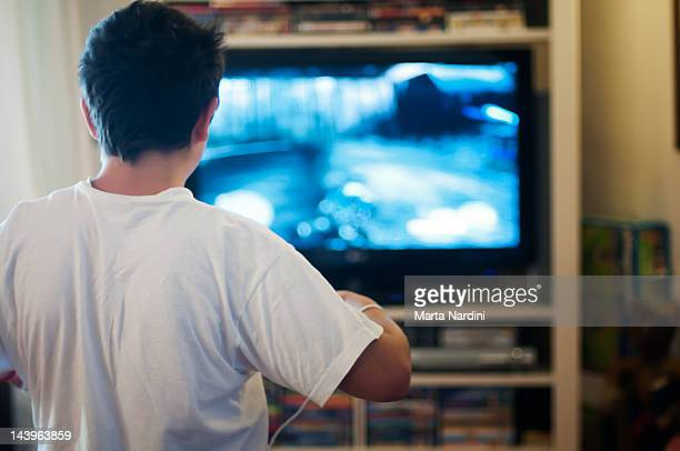 Boy playing at television video games