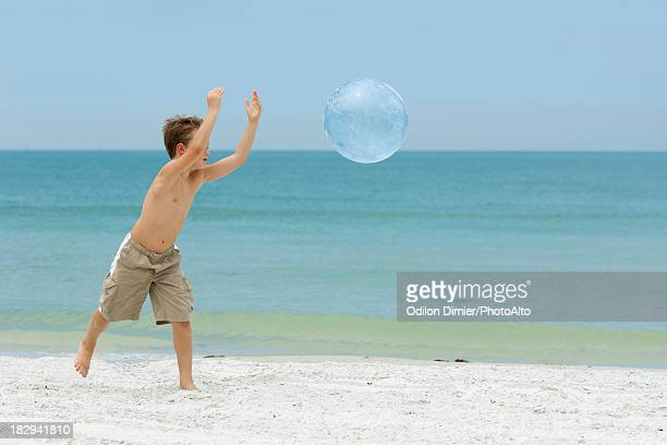 Boy playing ball on the beach
