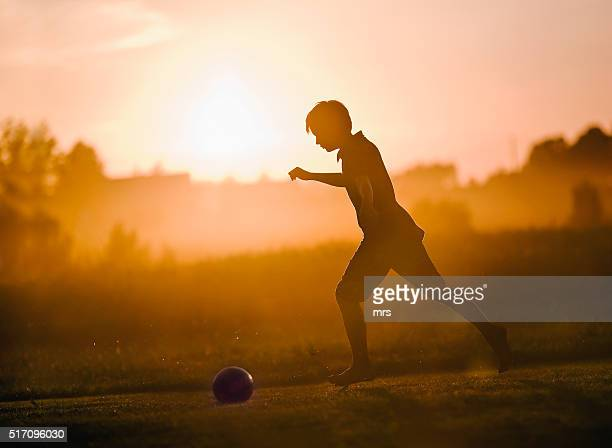 boy playing ball - football training stock pictures, royalty-free photos & images