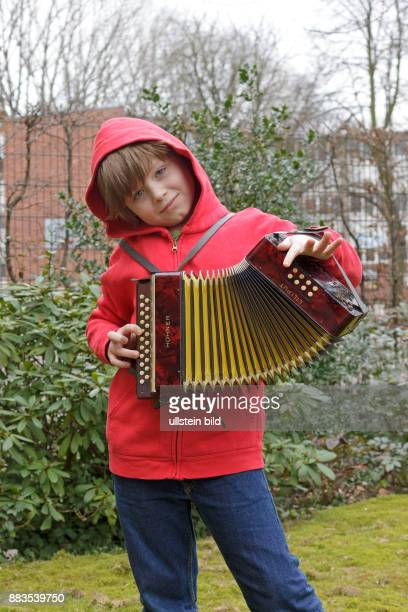boy playing bandoneon