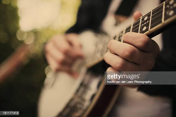 Boy playing banjo