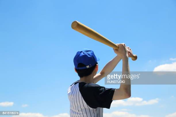 boy playing baseball in the sky