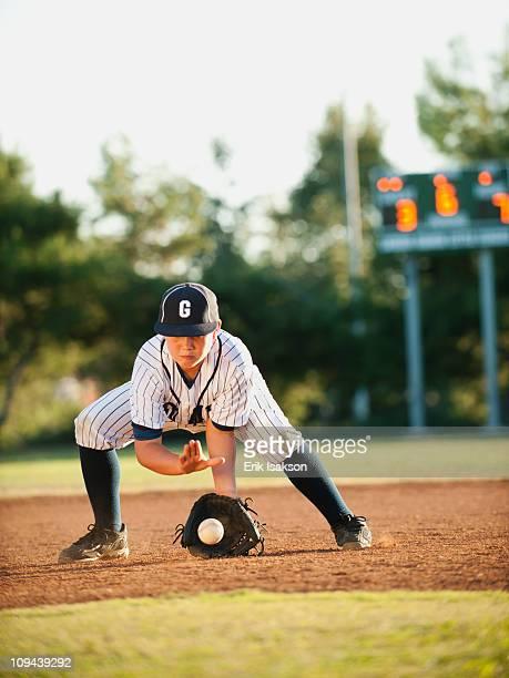 Boy (10-11) playing baseball