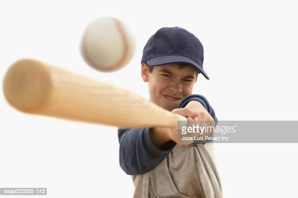 boy playing baseball - batting sports activity stock pictures, royalty-free photos & images