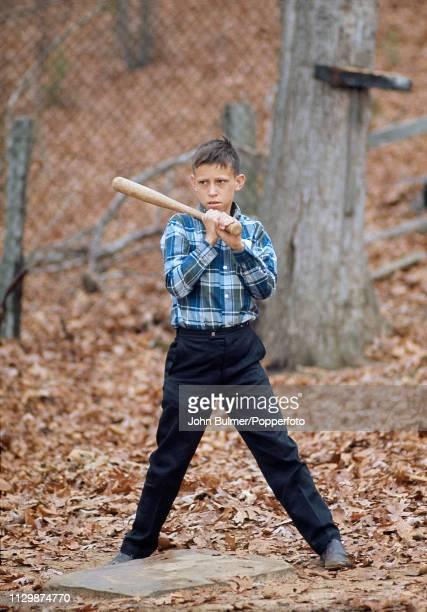 Boy playing baseball, Pike County, Kentucky, US, 1967.