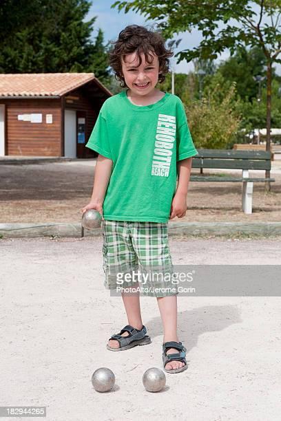Boy playing bocce ball