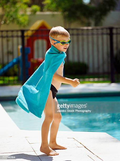 boy playing by swimming pool - kids swimsuit models stock pictures, royalty-free photos & images