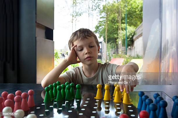 Boy playing Chinese checkers