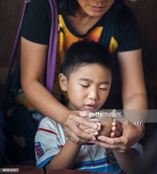 Boy playing clay and making pottery