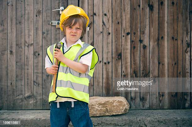 Boy playing construction worker