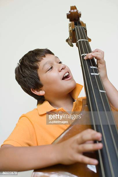 Boy playing double bass
