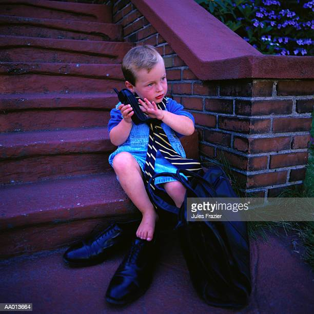Boy Playing Dress-up Using a Cellular Phone