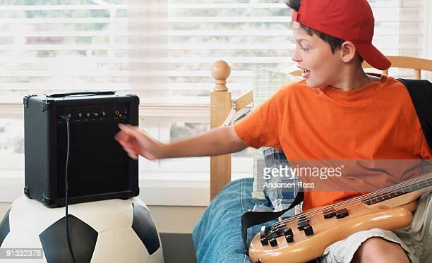 Boy playing electric bass