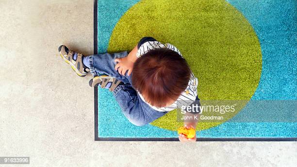 Boy playing from overhead
