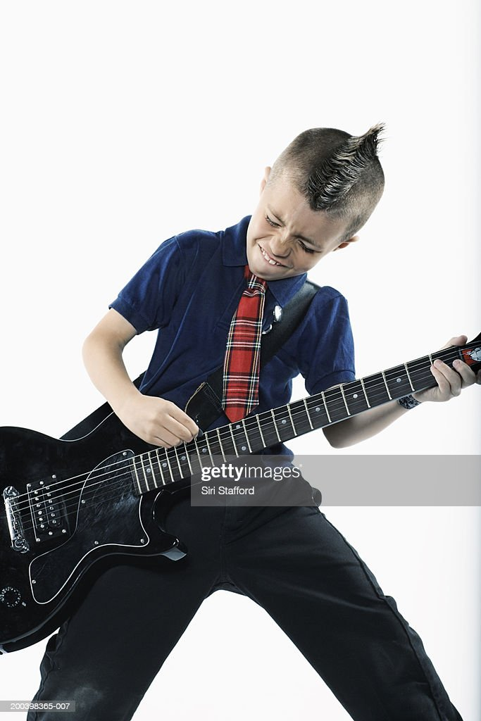 Boy (8-10) playing guitar : Stock Photo