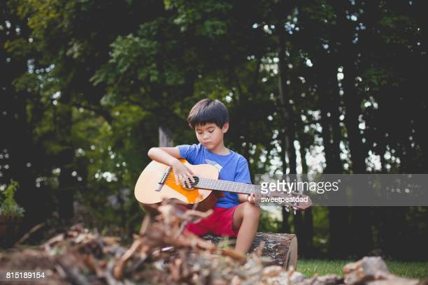 boy playing guitar - audition stock pictures, royalty-free photos & images