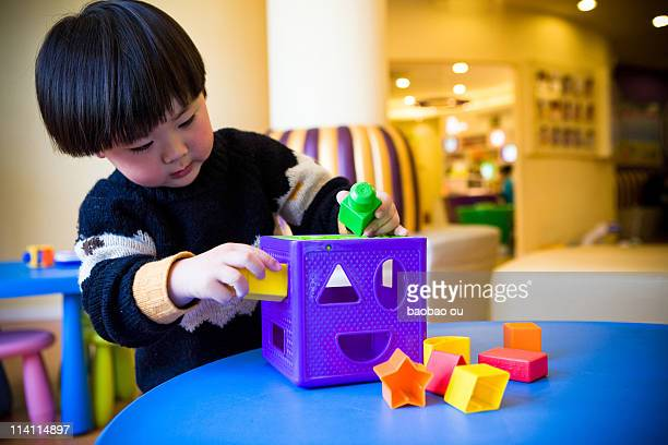 A boy playing his toy blocks