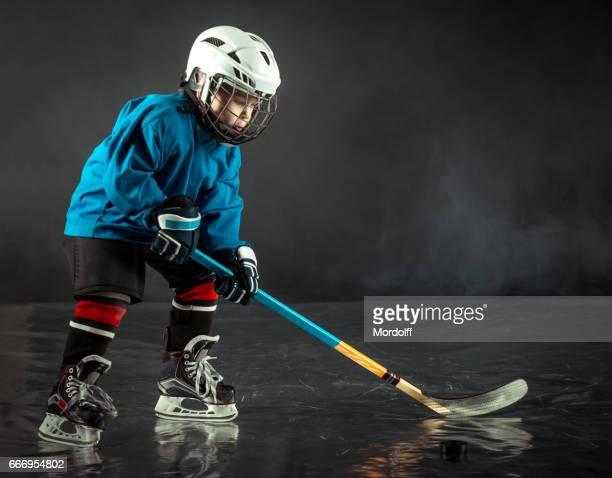 Boy Playing Ice Hockey