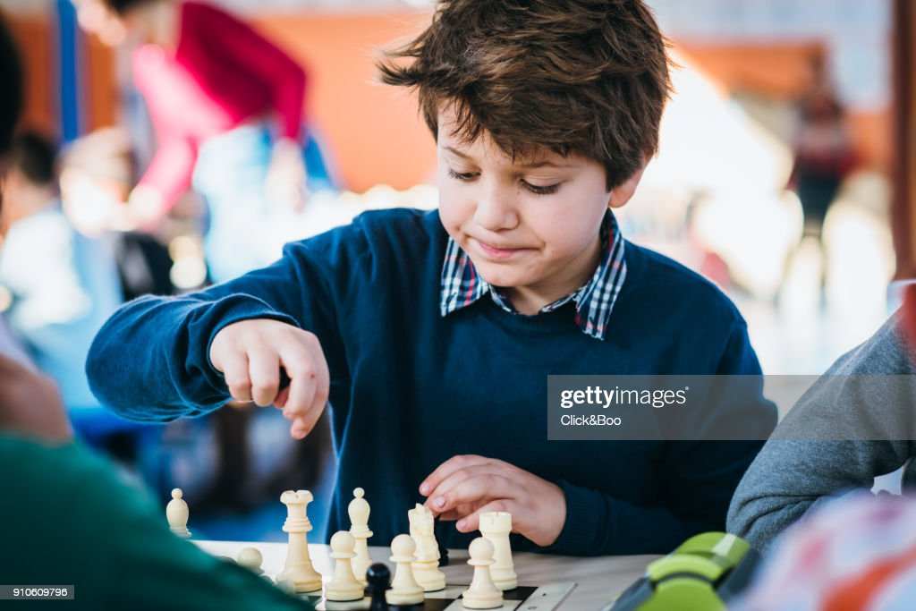 Boy playing in a chess school championship : Stock Photo