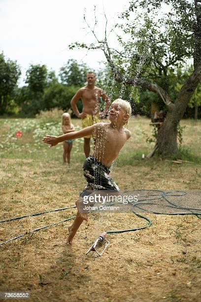 A boy playing in a garden.