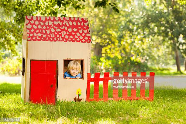 Boy Playing In a Playhouse