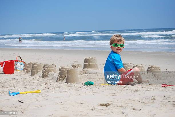 A boy playing in a sand pit