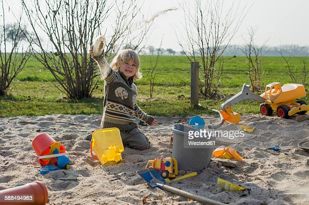 Boy playing in a sandbox