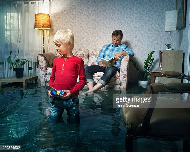 boy playing in flooded room