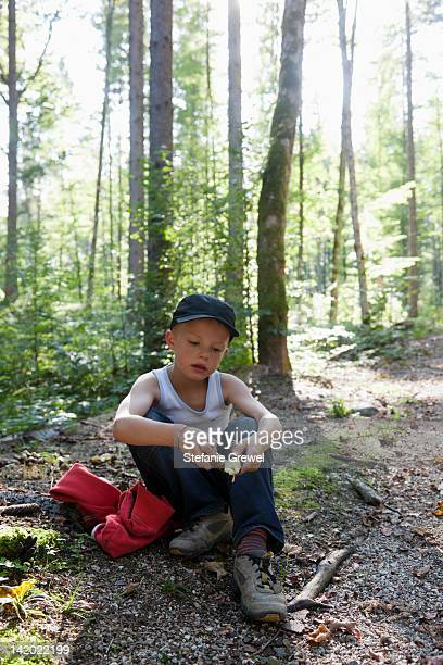 Boy playing in forest
