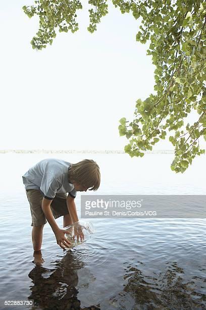 Boy playing in lake