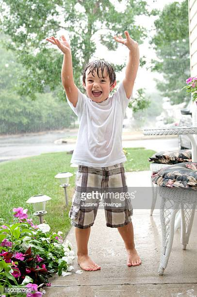 Boy playing in rain