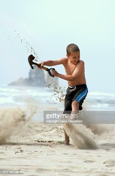 Boy playing in sand on Oregon coast