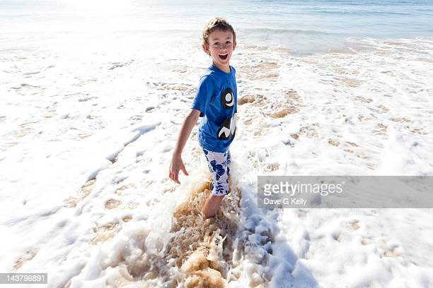 Boy playing in sea waves