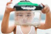 asian boy playing beachthe boy watching
