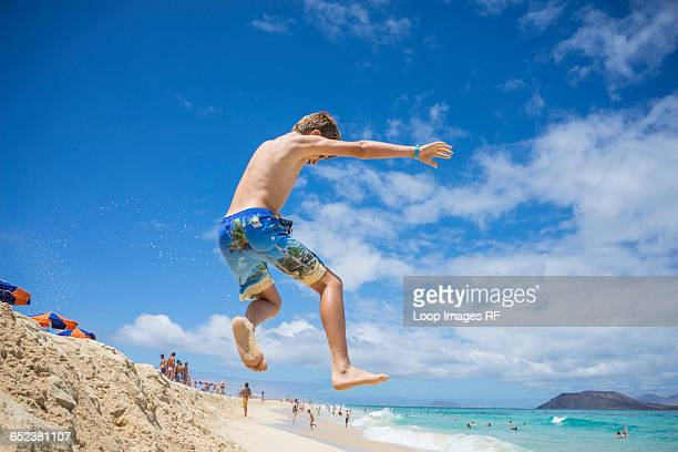 A boy playing in the dunes at Corralejo in Fuerteventura