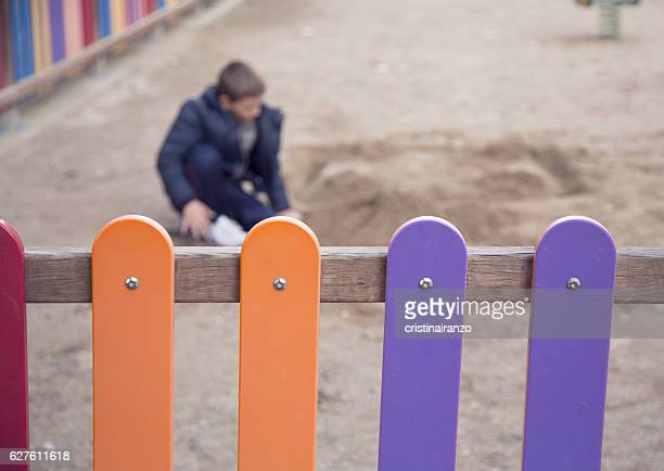 boy playing in the park - kidnapping stock photos and pictures