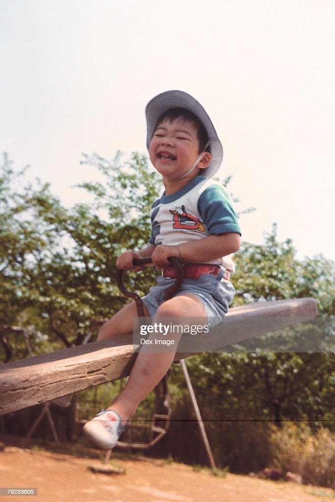 Boy playing in the playground : Stock Photo