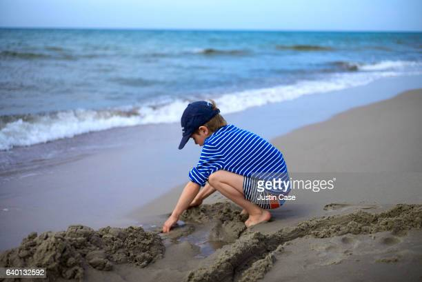 Boy playing in the sand by the Baltic Sea