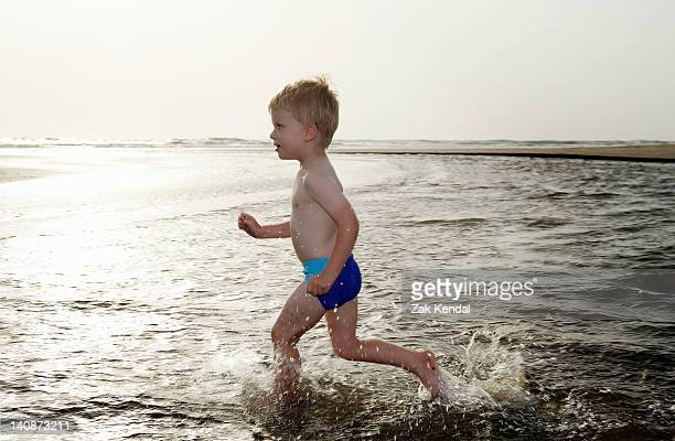 Boy playing in water at beach